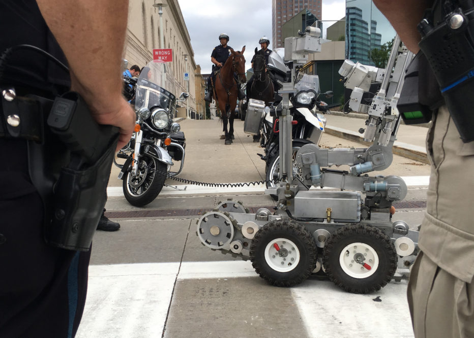 Police officers in Cleveland, Ohio demonstrate some of their security assets, including remote-controlled robots, horse-mounted officers, bomb-sniffing dogs on July 14 2016 ahead of the Republican National Convention.  The city, in conjunction with federal agencies, is boosting security for the high-profile event.  / AFP / Michael Mathes        (Photo credit should read MICHAEL MATHES/AFP/Getty Images)