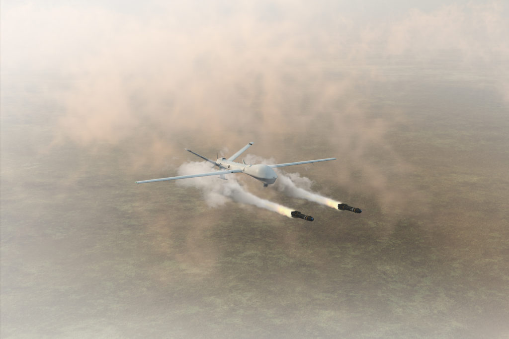 A military predator drone firing its two missiles.